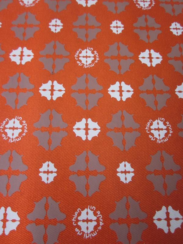 Tissu enduit motifs réf 53 bi-couleur orange et cognac